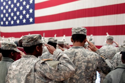 Soldiers salute the U.S. flag during a recitation of the Pledge of Allegiance at a welcome home ceremony for soldiers returning from a deployment in Afghanistan, at Fort. Carson, Colo., Wednesday Dec. 5, 2012. Nearly 300 soldiers of the 4th Brigade Combat Team, 4th Infantry Division, returned home after a tour of duty that began in February. (AP Photo/Brennan Linsley)